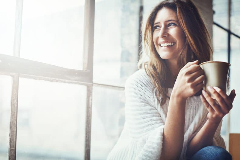women-smiling-with-coffee-cup