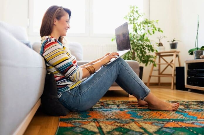 woman-sitting-on-floor-on-laptop