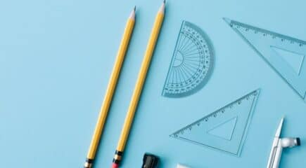 math-supplies-on-blue-surface